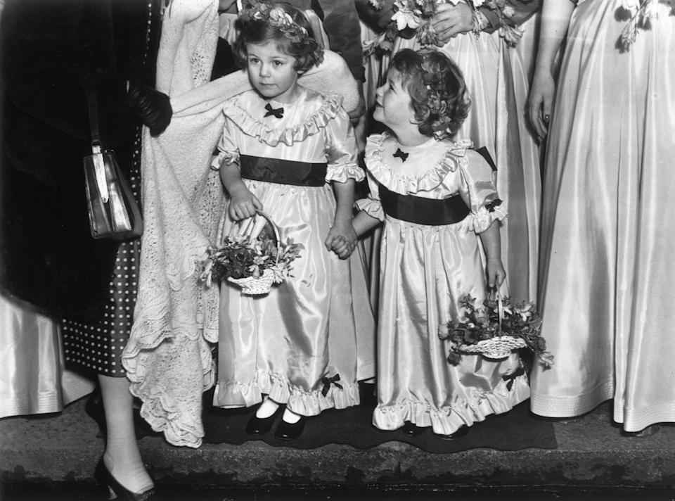 <p>Camilla, 4, and her sister Annabelle, 3, carry out bridesmaids duties at the wedding of Jeremy Cubitt and Diana du Cane in St. Mark's church in London. Camilla (now known as Camilla Parker Bowles, or Camilla, Duchess of Cornwall) would meet Charles while in their teens in the 1970s.</p>
