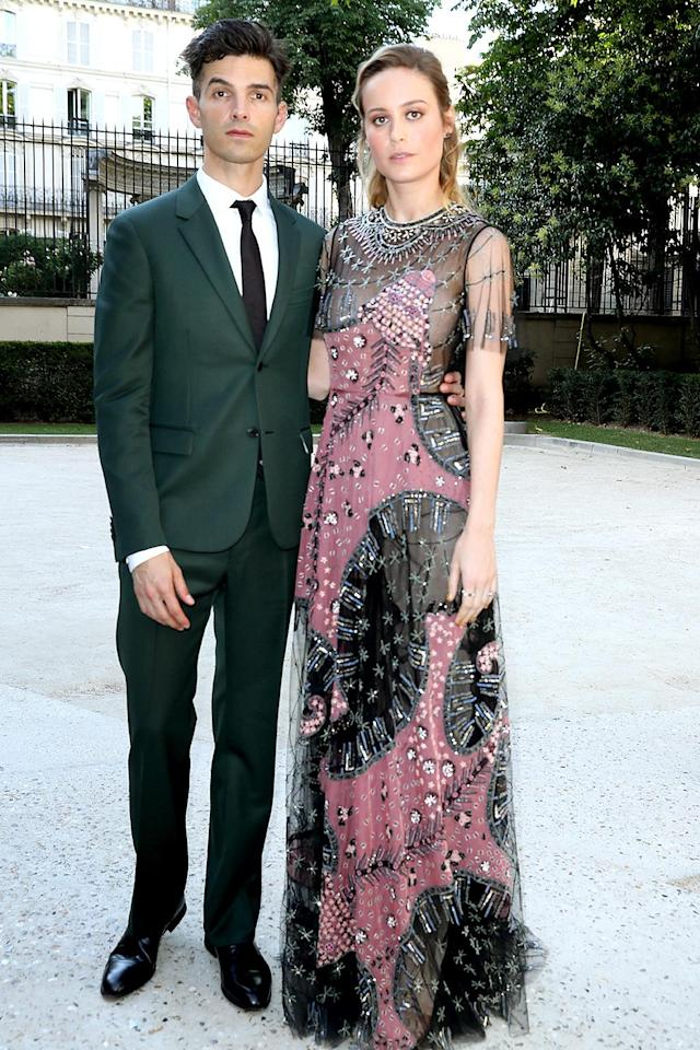 <p>Larson and fiancé Alex Greenwald gave their best serious faces, before sitting with the VIPs to see the haute couture looks that Valentino has planned for the world this fall. (Photo: Antonio de Moraes Barros Filho/WireImage) </p>