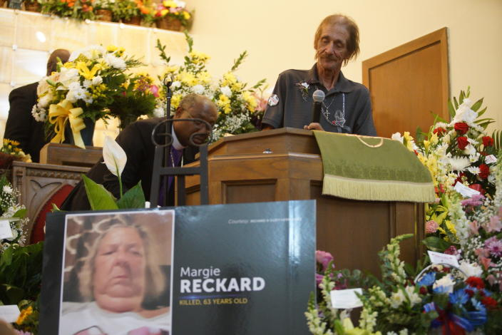 Moving: Mr Bosco, husband of Margie Reckard, speaks about his wife during her funeral (AP)