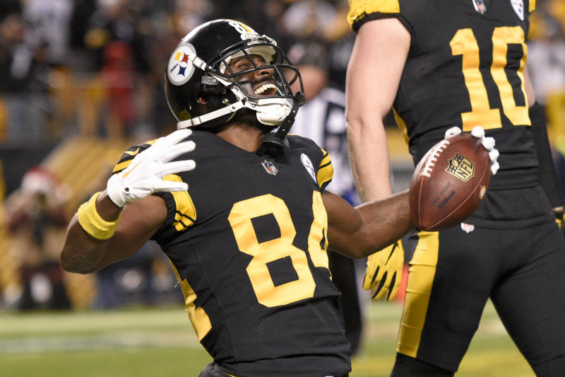 Pittsburgh Steelers wide receiver Antonio Brown (84) celebrates after catching a touchdown pass from quarterback Ben Roethlisberger during the first half of an NFL football game against the New England Patriots in Pittsburgh, Sunday, Dec. 16, 2018. (AP Photo/Don Wright)