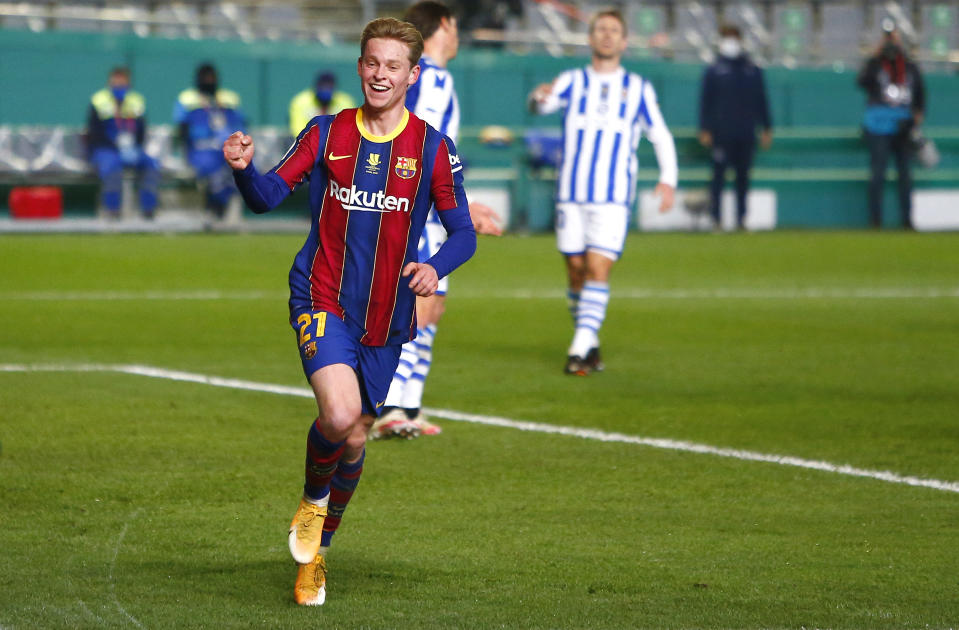 CORDOBA, SPAIN - JANUARY 13: Frenkie de Jong of Barcelona celebrates after scoring their team's first goal during the Supercopa de Espana Semi Final match between Real Sociedad and FC Barcelona at Estadio Nuevo Arcangel on January 13, 2021 in Cordoba, Spain. Sporting stadiums around Spain remain under strict restrictions due to the Coronavirus Pandemic as Government social distancing laws prohibit fans inside venues resulting in games being played behind closed doors. (Photo by Fran Santiago/Getty Images)