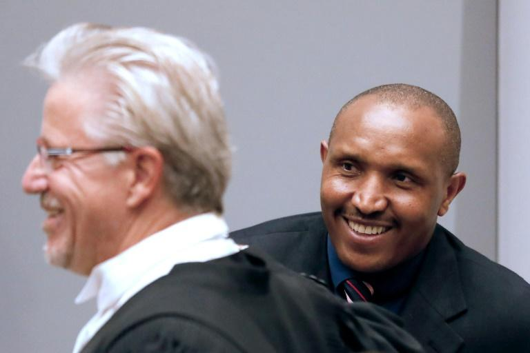Ntaganda and his lawyer Stephane Bourgon (L) have rejected the former commander's nickname of 'Terminator'