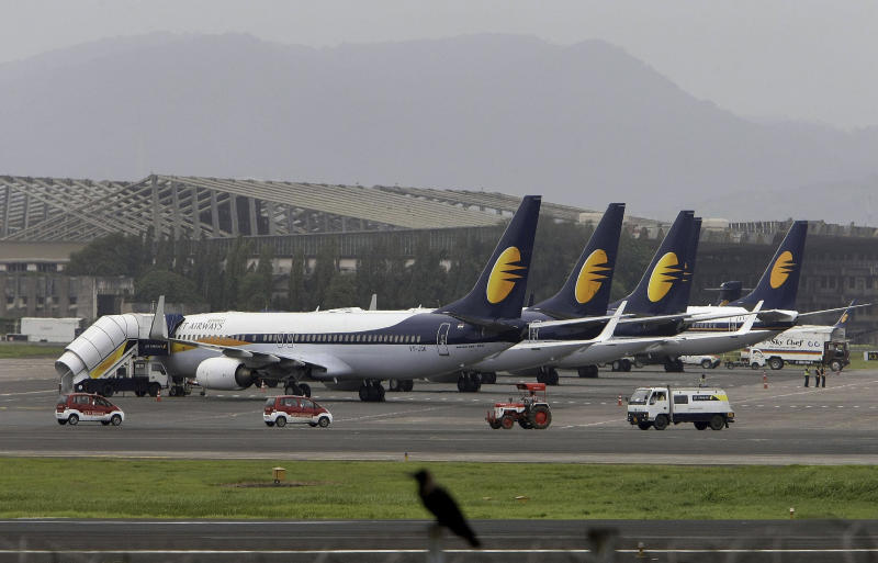 FILE - In this Sept. 9, 2009 file photo, Jet Airways planes are parked on the tarmac at the domestic airport terminal in Mumbai, India. In recent months, Abu Dhabi's Etihad Air announced it was taking a $379 million stake in India's Jet Airways. India has become a hot ticket for international carriers since opening its airline industry to foreign investors last year. But the potential of a giant market where only a sliver of the population travel by plane also comes with a catch: airlines in India are vastly unprofitable thanks to sky-high costs and cut-throat competition. (AP Photo/Rajanish Kakade, file)