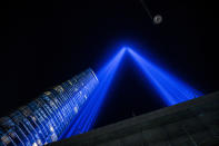 """The annual """"Tribute in Light"""" shines into the sky on the 20th anniversary of the Sept. 11, 2001 attacks on Saturday, Sept. 11, 2021, in New York. (AP Photo/Brittainy Newman)"""