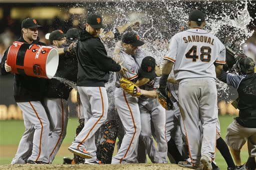 The water bath hits the San Francisco Giants as they celebrate the no hitter thrown by Giants pitcher Tim Lincecum against the San Diego Padres in a baseball game in San Diego, Saturday, July 13, 2013. The Giants won the game 9-0. Tim Lincecum has thrown his first career no-hitter and the second in the majors in 11 days, a gem saved by a spectacular diving catch by right fielder Hunter Pence in the San Francisco Giants' 9-0 win against the last-place San Diego Padres on Saturday night. (AP Photo/Lenny Ignelzi)