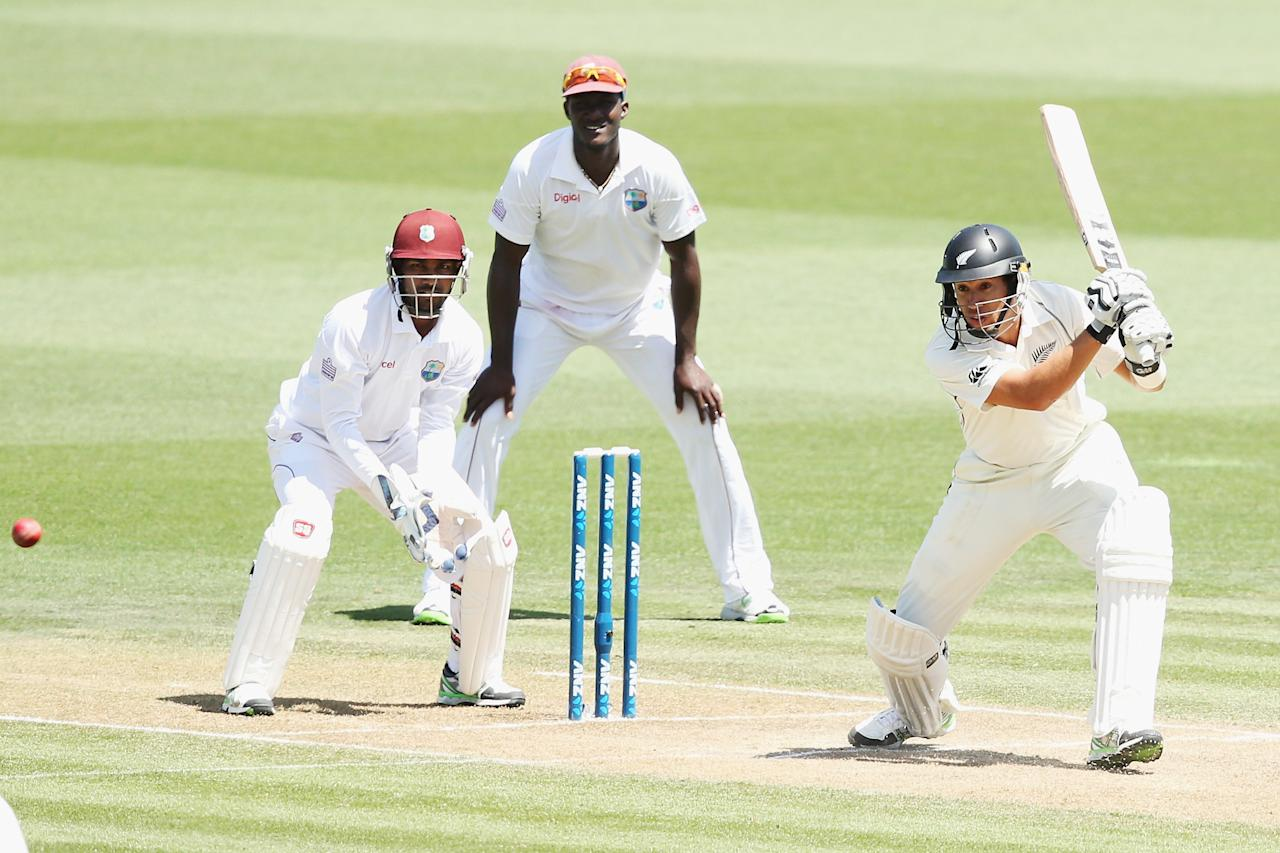 HAMILTON, NEW ZEALAND - DECEMBER 20: Ross Taylor of New Zealand drives the ball away for four rus during day two of the Third Test match between New Zealand and the West Indies at Seddon Park on December 20, 2013 in Hamilton, New Zealand.  (Photo by Hannah Johnston/Getty Images)