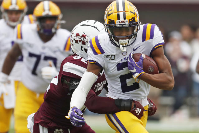 LSU wide receiver Justin Jefferson (2) tries to fight off a tackle by Mississippi State safety Brian Cole II (32) after a pass reception during the first half of their NCAA college football game in Starkville, Miss., Saturday, Oct. 19, 2019. (AP Photo/Rogelio V. Solis)
