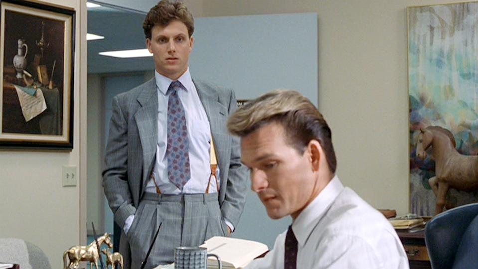 """LOS ANGELES - JULY 13: The movie """"Ghost"""", directed by Jerry Zucker and written by Bruce Joel Rubin. Seen here, from left, Tony Goldwyn as Carl Bruner observes Patrick Swayze as Sam Wheat working at Market Security Bank & Trust. Initial theatrical release July 13, 1990. Screen capture. Paramount Pictures. (Photo by CBS via Getty Images)"""