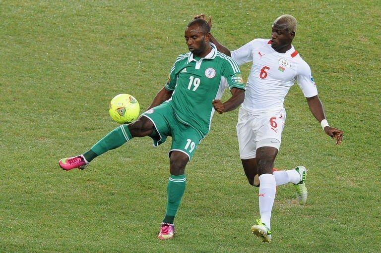 Nigeria's Sunday Mba (L) is challenged by Burkina's Djakaridja Kone during the Cup of Nations final on February 10, 2013