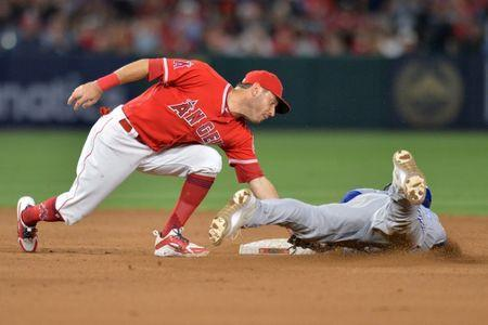 Jun 23, 2018; Anaheim, CA, USA; Los Angeles Angels second baseman Ian Kinsler (3) tags out Toronto Blue Jays catcher Russell Martin (right) as he attempts to steal second in the ninth inning at Angel Stadium of Anaheim. Mandatory Credit: Jake Roth-USA TODAY Sports