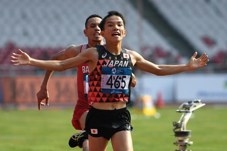 Japan's Hiroto Inoue won the marathon by a whisker