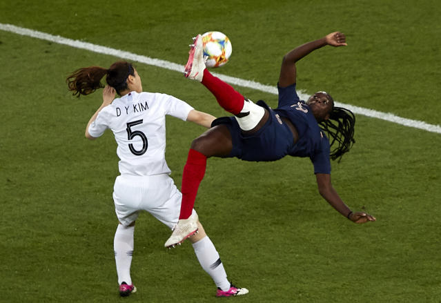 Griedge Mbock Bathy of France attempts a scissor kick shot on goal in front Kim Doyeon of Korea Republic during the 2019 FIFA Women's World Cup France group A match between France and Korea Republic at Parc des Princes on June 07, 2019 in Paris, France. (Photo by Quality Sport Images/Getty Images)