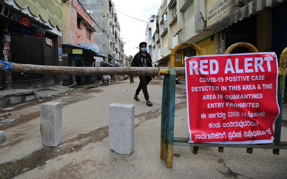 A makeshift barricade set up to restrict entry in a containment zone during lockdown in Bengaluru, India - AP