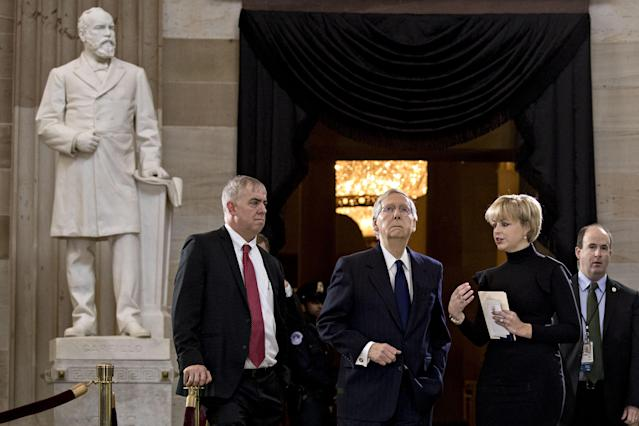 <p>Senate Majority Leader Mitch McConnell, a Republican from Kentucky, center, conducts a walkthrough before a service for the late Reverend Billy Graham at the U.S. Capitol Rotunda in Washington on Wednesday, Feb. 28, 2018. (Photo: Andrew Harrer/Bloomberg via Getty Images </p>