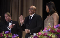<p>Larry Wilmore, guest host from Comedy Central, center, is introduced at the annual White House Correspondents' Dinner, April 30. Major Garrett, of CBS News, and Michelle Obama watch. <i>(Photo: Susan Walsh/AP)</i></p>