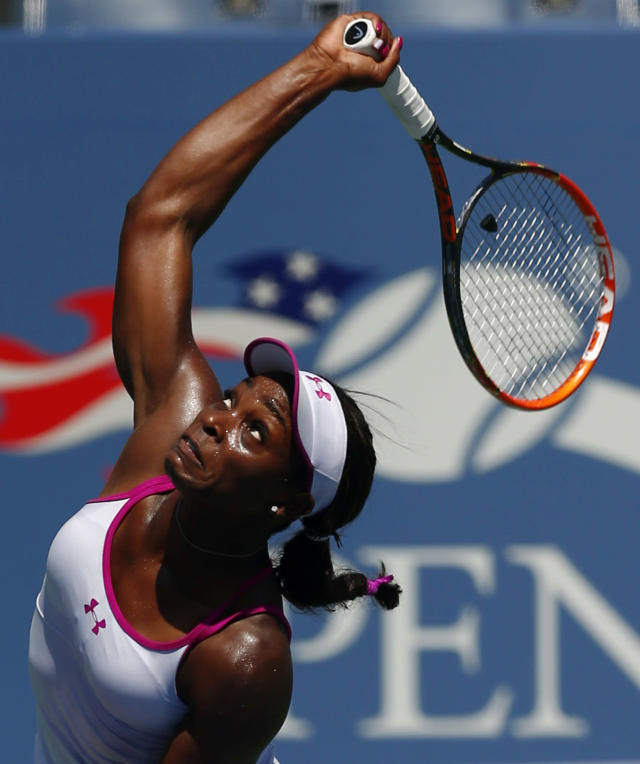Sloane Stephens, of the United States, serves against Johanna Larsson, of Sweden, during the second round of the 2014 U.S. Open tennis tournament, Wednesday, Aug. 27, 2014, in New York. (AP Photo/Matt Rourke)