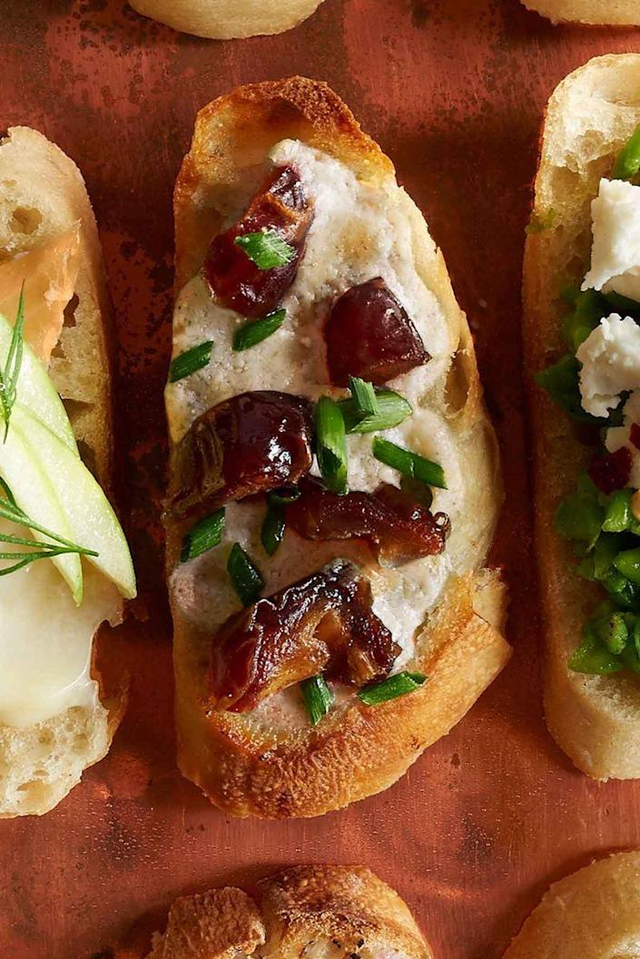"""<p>The best part about crostini is that you can get really creative with the toppings. For example, this easy recipe includes rich blue cheese and sweet dates. </p><p><em>Get the recipe at <a href=""""http://www.countryliving.com/food-drinks/recipes/a36522/blue-cheese-and-date-crostini/"""" rel=""""nofollow noopener"""" target=""""_blank"""" data-ylk=""""slk:Country Living"""" class=""""link rapid-noclick-resp"""">Country Living</a>.</em></p>"""