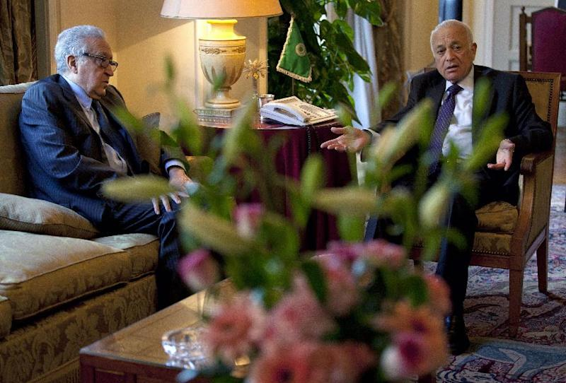 Arab League chief Nabil Elaraby, right, talks with U.N.-Arab League envoy to Syria Lakhdar Brahimi during their meeting at the Arab League headquarters, in Cairo, Egypt, Sunday, Feb. 17, 2013. Brahimi, and Elaraby threw their weight behind the call for a dialogue to resolve the Syrian conflict made by Moaz al-Khatib, president of the opposition coalition. The U.N. says nearly 70,000 people have been killed in Syria's conflict since March 2011. (AP Photo/Nasser Nasser)