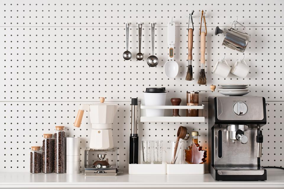 Espresso Coffee Maker and Accessories Knolling on White Colored Pegboard Background.