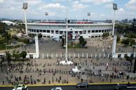 Chileans line up outside Santiago's National Stadium - where opponents of the 1970s military dictatorship were tortured - to vote on whether they want a new constitution