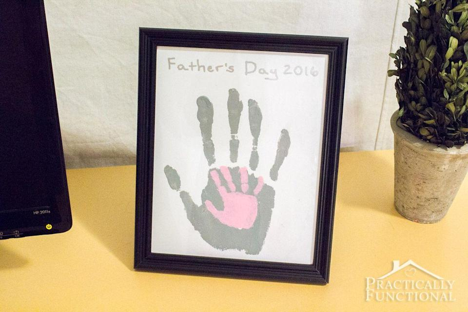 """<p>Holding hands, in art form! </p><p><strong><em>Get the tutorial at <a href=""""https://www.practicallyfunctional.com/diy-fathers-day-handprint-craft/"""" rel=""""nofollow noopener"""" target=""""_blank"""" data-ylk=""""slk:Practically Functional."""" class=""""link rapid-noclick-resp"""">Practically Functional.</a></em></strong></p>"""