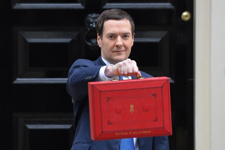 Chancellor of the Exchequer George Osborne holds the budget box outside 11 Downing Street in London on March 19, 2014