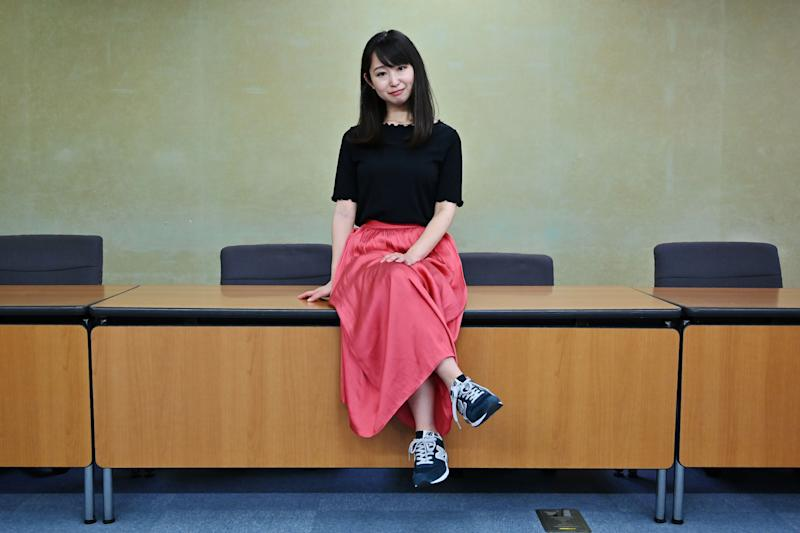"""Yumi Ishikawa, leader and founder of the KuToo movement, poses after a press conference in Tokyo on June 3, 2019. - A group of Japanese women on June 3 submitted a petition to the government to protest what they say is a de-facto requirement for female staff to wear high heels at work. The online campaign #KuToo, using a pun from a Japanese word """"kutsu"""" -- that can mean either """"shoes"""" or """"pain"""" -- was launched by actress and freelance writer Yumi Ishikawa and quickly won support from nearly 19,000 people online. (Photo by Charly TRIBALLEAU / AFP) (Photo credit should read CHARLY TRIBALLEAU/AFP/Getty Images)"""