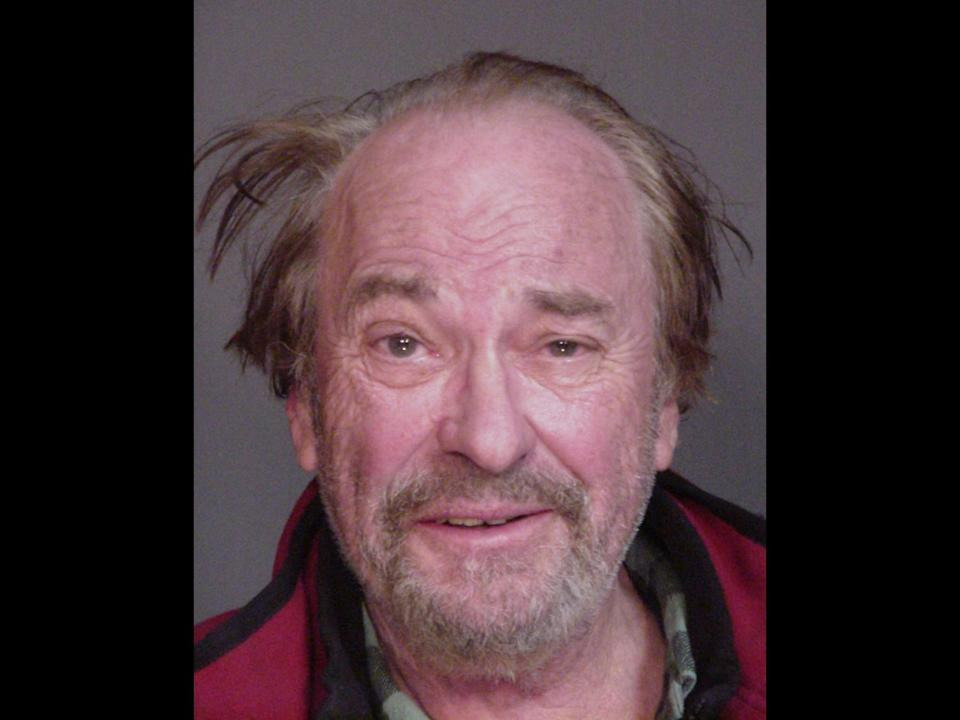 Rip Torn mugshot, actor after his arrest for driving while intoxicated, New York State Police photo on black