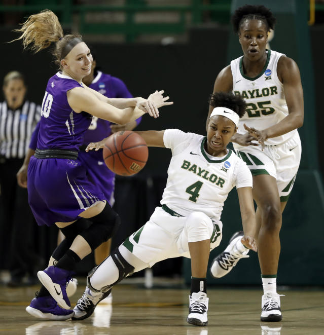 Abilene Christian guard Breanna Wright (10) and Baylor guard Honesty Scott-Grayson (4) collide at mid court competing for control of a loose ball as center Queen Egbo (25) watches in the second half of a first-round game in the NCAA women's college basketball tournament in Waco, Texas, Saturday March 23, 2019. (AP Photo/Tony Gutierrez)