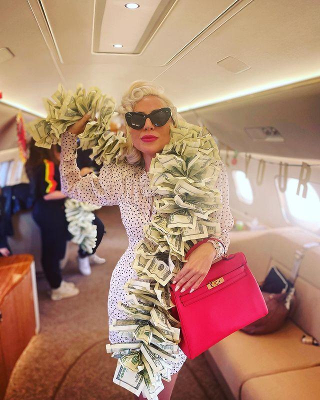 """<p>The queen of over-the-top fashion boarded a plane to Las Vegas wearing a stole made entirely from $100 bills (yes, you read that right) over a white polka dot dress and carrying a hot pink Birkin bag.</p><p><a class=""""link rapid-noclick-resp"""" href=""""https://www.selfridges.com/GB/en/cat/chi-chi-london-ardin-polka-dot-print-crepe-maxi-dress_R03802473/?previewAttribute=WHITE"""" rel=""""nofollow noopener"""" target=""""_blank"""" data-ylk=""""slk:SHOP POLKA DOT DRESS"""">SHOP POLKA DOT DRESS</a></p><p><a href=""""https://www.instagram.com/p/CU8wESIlXq4/"""" rel=""""nofollow noopener"""" target=""""_blank"""" data-ylk=""""slk:See the original post on Instagram"""" class=""""link rapid-noclick-resp"""">See the original post on Instagram</a></p>"""