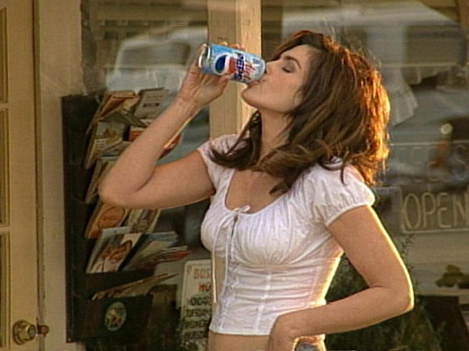 402614 02: Supermodel Cindy Crawford drinks a Pepsi in this undated company supplied photograph. Crawford will star in a new Diet Pepsi commercial during the 74th Annual Academy Awards airing March 24, 2002 on ABC-TV. The new Diet Pepsi spot updates an award-winning ad produced for regular Pepsi in 1991, in which a pair of awestruck boys watched Crawford approach a Pepsi vending machine. In the new commercial, titled
