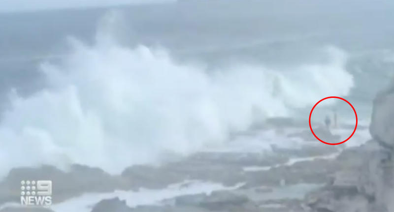 The moment a husband and wife are swept out to see by massive waves at Bondi Beach.