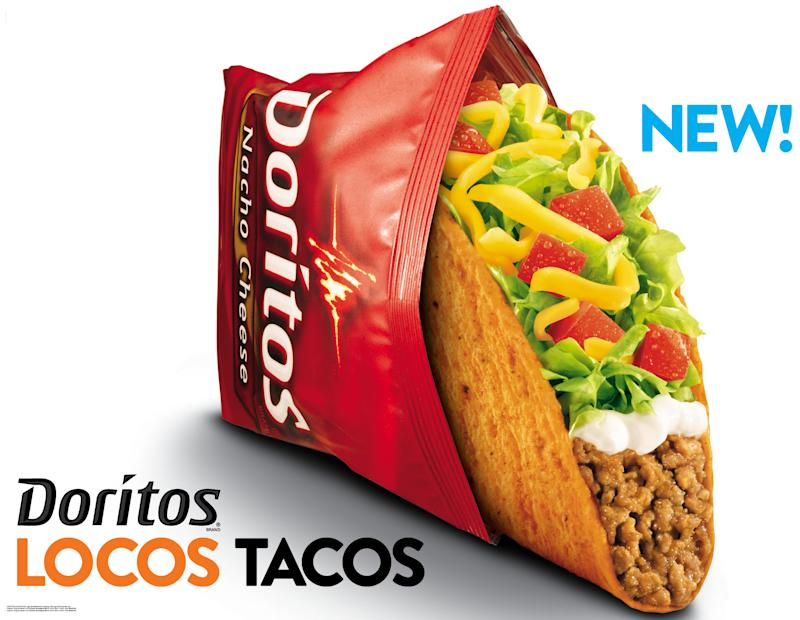This photo provided by Taco Bell shows a new advertisement for Doritos Locos Tacos shells.  The Mexican-style chain rolls out the Doritos Locos Tacos shells at midnight on Wednesday, March 7, 2012 at its nearly 5,600 restaurants nationwide. The fast-food chain, a unit of Yum Brands Inc., calls it the biggest product launch in its 50-year history. (AP Photo/Taco Bell)