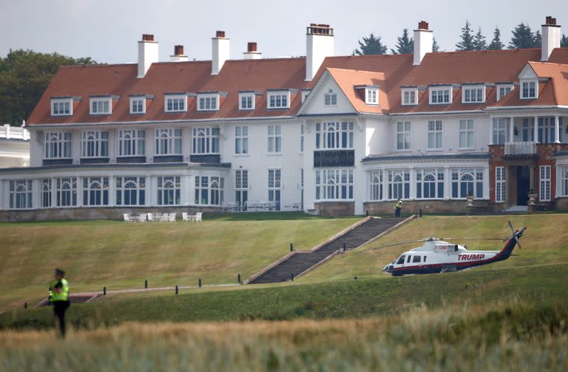FILE PHOTO: A police officer stands in the grounds of the golf resort owned by U.S. President Donald Trump, during Trump's stay at the resort, in Turnberry
