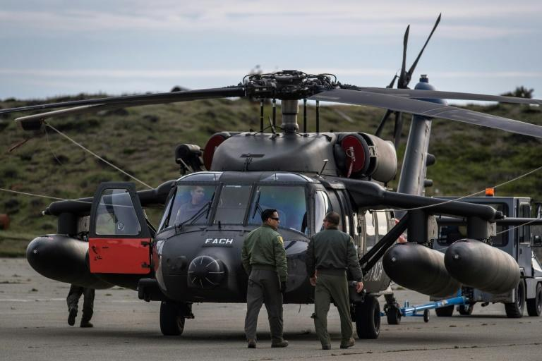 Rescue planes, including this Black Hawk helicopter, and ships continued searching waters off the southern tip of South America for the missing plane