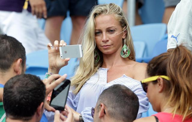 Valentina Baldini, girlfriend of Italy's Andrea Pirlo, takes a photo prior to the group D World Cup soccer match between Italy and Uruguay at the Arena das Dunas in Natal, Brazil, Tuesday, June 24, 2014. (AP Photo/Antonio Calanni)