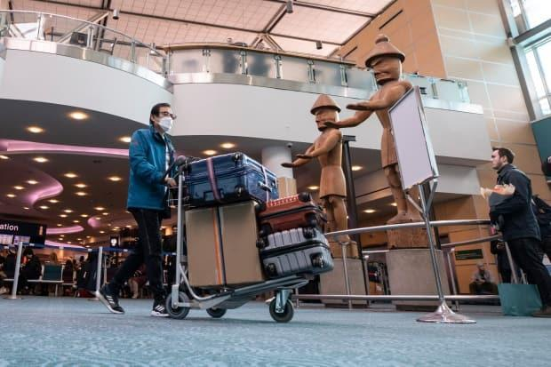 Passengers arrive through international arrivals at Vancouver's international airport (YVR) in Richmond, British Columbia on Tuesday, Jan. 28, 2020.