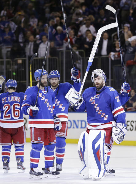 New York Rangers goalie Henrik Lundqvist (30) and teammates salute the crowd after beating the Los Angeles Kings 2-1 in Game 4 of the NHL hockey Stanley Cup Final, Wednesday, June 11, 2014, in New York. (AP Photo/Seth Wenig)