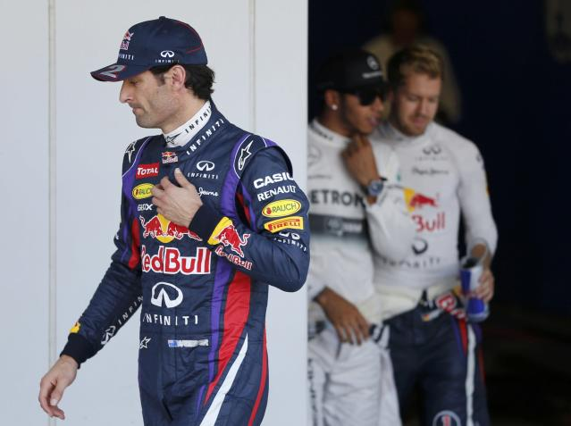 Red Bull Formula One driver Mark Webber of Australia walks after taking pole position after the qualifying session of the Japanese F1 Grand Prix at the Suzuka circuit October 12, 2013. REUTERS/Issei Kato (JAPAN - Tags: SPORT MOTORSPORT F1)