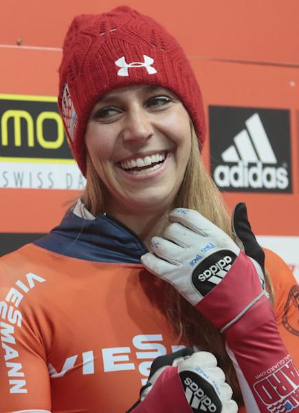 Winner Noelle Pikus-Pace of the U.S. react after the finish in the women's Bob event at the FIBT Bob & Skeleton World Cup 2013, in Krasnaya Polyana resort, east of Sochi, Russia, Saturday, Feb. 16, 2013. (AP Photo/Mikhail Metzel)