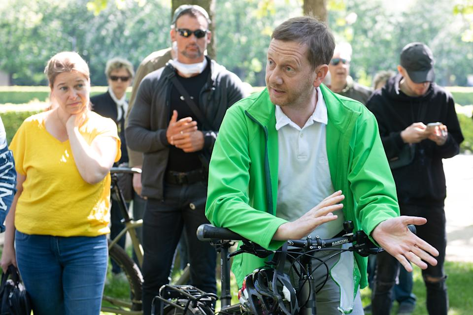 16 May 2020, Saxony, Dresden: Michael Kretschmer (CDU), Prime Minister of Saxony, speaks in the Great Garden with supporters of conspiracy theories on the Corona crisis. Photo: Sebastian Kahnert/dpa-Zentralbild/dpa (Photo by Sebastian Kahnert/picture alliance via Getty Images)