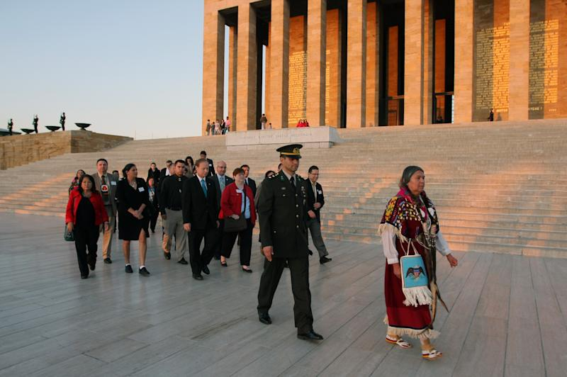 Followed by a Turkish army officer, Patricia Whitefoot of Yakama Nation and President of National Indian Education Association, front, leads a delegation of Native Americans who represent 17 tribes from at least 10 U.S. states, during a visit to the mausoleum of the founder of modern Turkey, Mustafa Kemal Ataturk, in Ankara, Turkey,  Thursday, Nov. 11,  2010. Native American tribal leaders seeking trade ties with Turkish companies have offered them tax incentives to operate in their territories in the United States, the organizers of the trip said Thursday.(AP Photo/Selcan Hacaoglu)