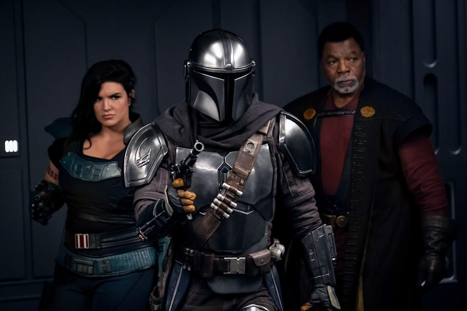 Gina Carano, Pedro Pascal and Carl Weathers in a still from The Mandalorian S2. (Disney+)