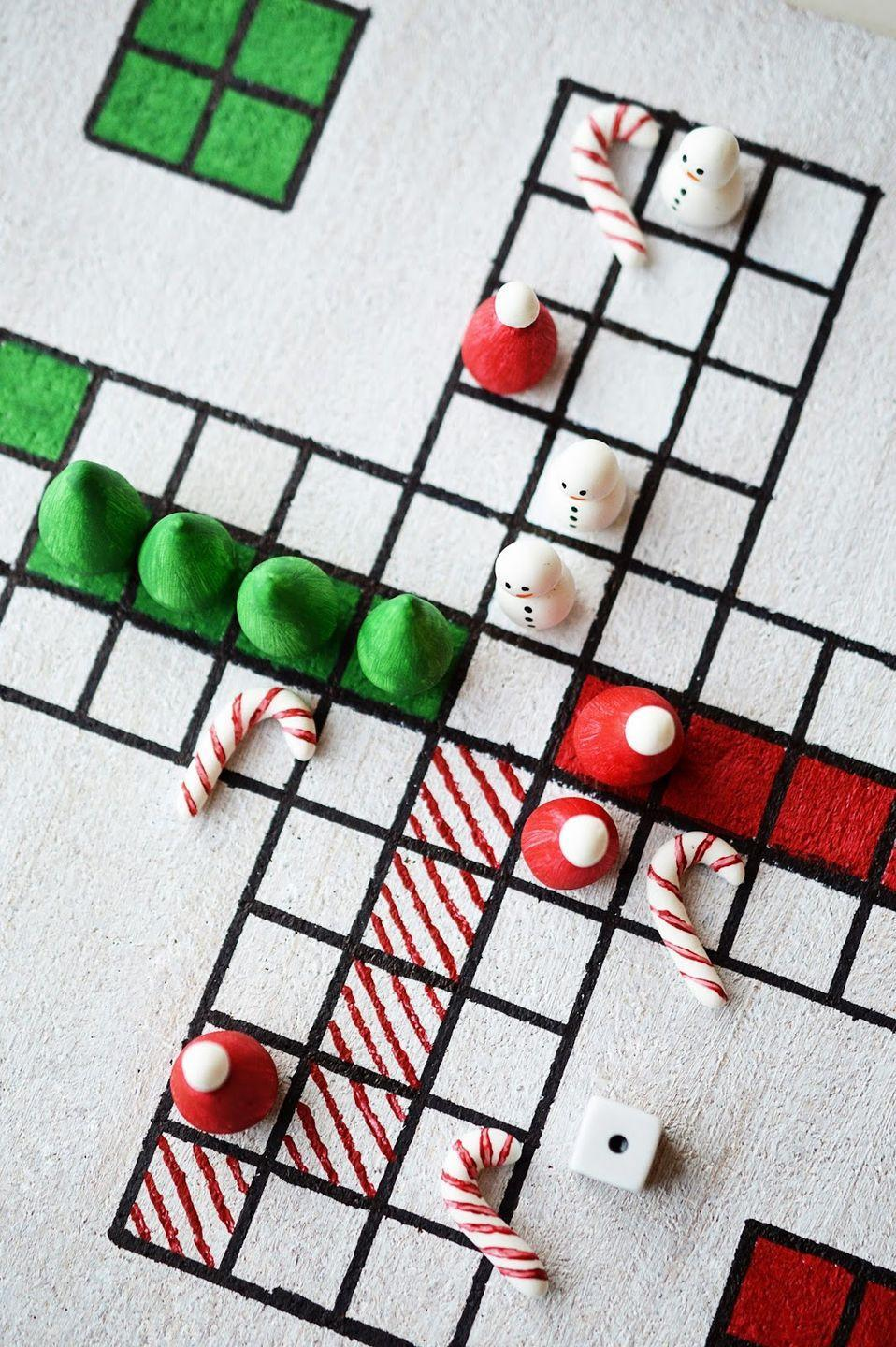 """<p>This super crafty blogger made her own clay game pieces and cork board for this festive spin on the classic board game <a href=""""https://www.amazon.com/Hasbro-390095-Sorry-Amazon-Exclusive/dp/B00000IWD0?tag=syn-yahoo-20&ascsubtag=%5Bartid%7C10055.g.2725%5Bsrc%7Cyahoo-us"""" rel=""""nofollow noopener"""" target=""""_blank"""" data-ylk=""""slk:Sorry!"""" class=""""link rapid-noclick-resp""""><em>Sorry!</em></a>. If you don't have the time or skills to do the same, use <a href=""""https://www.amazon.com/HERSHEYS-Holiday-Chocolate-Assortment-Cookies/dp/B01JRIZ258/?tag=syn-yahoo-20&ascsubtag=%5Bartid%7C10055.g.2725%5Bsrc%7Cyahoo-us"""" rel=""""nofollow noopener"""" target=""""_blank"""" data-ylk=""""slk:Christmas Hershey's Kisses"""" class=""""link rapid-noclick-resp"""">Christmas Hershey's Kisses</a> on a regulation board to give it a little more holiday spirit. The winner gets to eat their team (and maybe the opposing ones, too). </p><p><em><a href=""""http://mottesblog.blogspot.com/2015/12/diy-christmas-board-game.html"""" rel=""""nofollow noopener"""" target=""""_blank"""" data-ylk=""""slk:Get the tutorial at Motte »"""" class=""""link rapid-noclick-resp"""">Get the tutorial at Motte »</a></em><br></p>"""