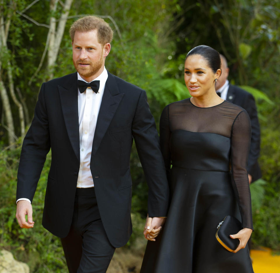 """January 20th 2020 - Buckingham Palace has announced that Prince Harry and Duchess Meghan will no longer use """"royal highness"""" titles and will not receive public money for their royal duties. Additionally, as part of the terms of surrendering their royal responsibilities, Harry and Meghan will repay the $3.1 million cost of taxpayers' money that was spent renovating Frogmore Cottage - their home near Windsor Castle. - January 9th 2020 - Prince Harry The Duke of Sussex and Duchess Meghan of Sussex intend to step back their duties and responsibilities as senior members of the British Royal Family. - File Photo by: zz/KGC-09/STAR MAX/IPx 2019 7/14/19 Prince Harry and Duchess Meghan at the premiere of """"The Lion King"""" in London, England, UK."""