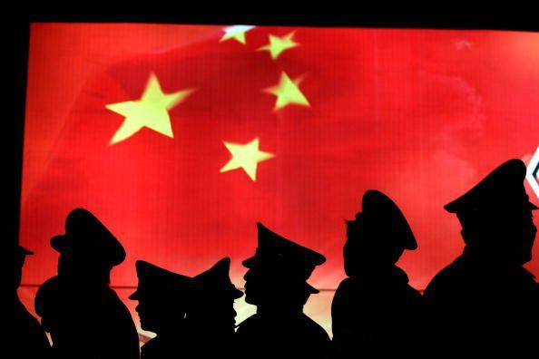 BEIJING, CHINA - MARCH 1: (CHINA OUT) Security guard walk past the Chinese national flag at the Military Museum of Chinese People's Revolution on March 1, 2008 in Beijing, China. From March 1, the Military Museum of Chinese People's Revolution becomes the first national level museum which opens to the public for free in Beijing. (Photo by China Photos/Getty Images) Photographer: China Photos/Getty Images AsiaPac