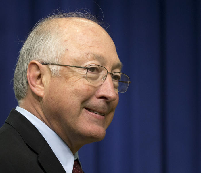 FILE - This Jan. 16, 2013 file photo shows outgoing Interior Secretary Ken Salazar entering the South Court Auditorium at the White House in Washington. The White House says tackling climate change and enhancing energy security will be among President Barack Obama's top priorities in his second term. Obama will have to do that work with new heads of the agencies responsible for the environment. Interior Secretary Ken Salazar, Environmental Protection chief Lisa Jackson and Jane Lubchenco, head of the National Oceanic and Atmospheric Administration, all have announced they are leaving. Energy Secretary Steven Chu is expected to follow his colleagues out the door in coming weeks. (AP Photo/Carolyn Kaster, File)