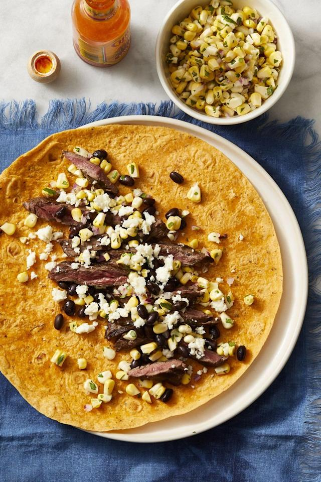 "<p>Spice-up a favorite taco combo — steak, corn, black beans, and queso fresco — by stuffing it into a wrap instead!</p><p><em><a href=""https://www.goodhousekeeping.com/food-recipes/a28223751/southwest-steak-wraps-recipe/"" target=""_blank"">Get the recipe for Southwest Steak Wraps »</a></em></p><p><strong>RELATED:</strong> <a href=""https://www.goodhousekeeping.com/food-recipes/easy/g28136655/best-wrap-recipes/"" target=""_blank"">30 Wrap Recipes to Bring Your Lunch Game to the Next Level</a></p>"