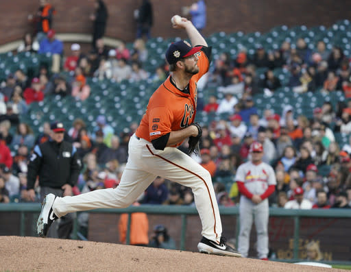 San Francisco Giants pitcher Drew Pomeranz throws to a St. Louis Cardinals batter during the first inning of a baseball game in San Francisco, Friday, July 5, 2019. (AP Photo/Tony Avelar)