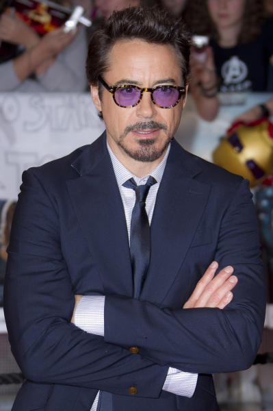 """FILE - In this April 19, 2012 file photo, actor Robert Downey Jr arrives for the European Premiere of """"The Avengers,"""" in London. Representatives at Marvel Entertainment announced that Downey Jr. sustained an injury to his foot while performing a stunt on the set of """"Iron Man 3."""" Marvel says there will be a short delay in production while Downey recuperates. (AP Photo/Joel Ryan, file)"""